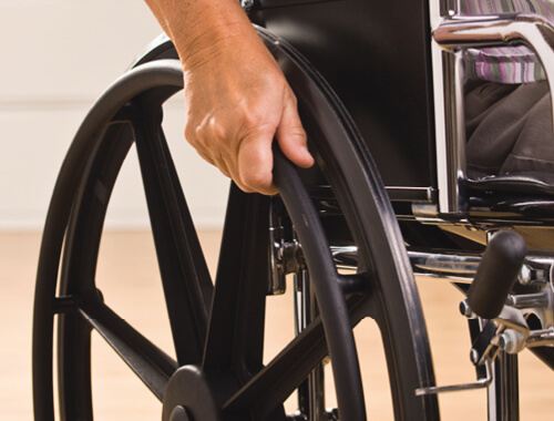 close up of wheelchair wheel being used.