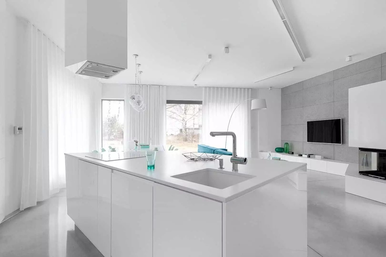 The traditional architecture modern interior and a combination of turquoise mint colors can make the interior looks spacious and also bright