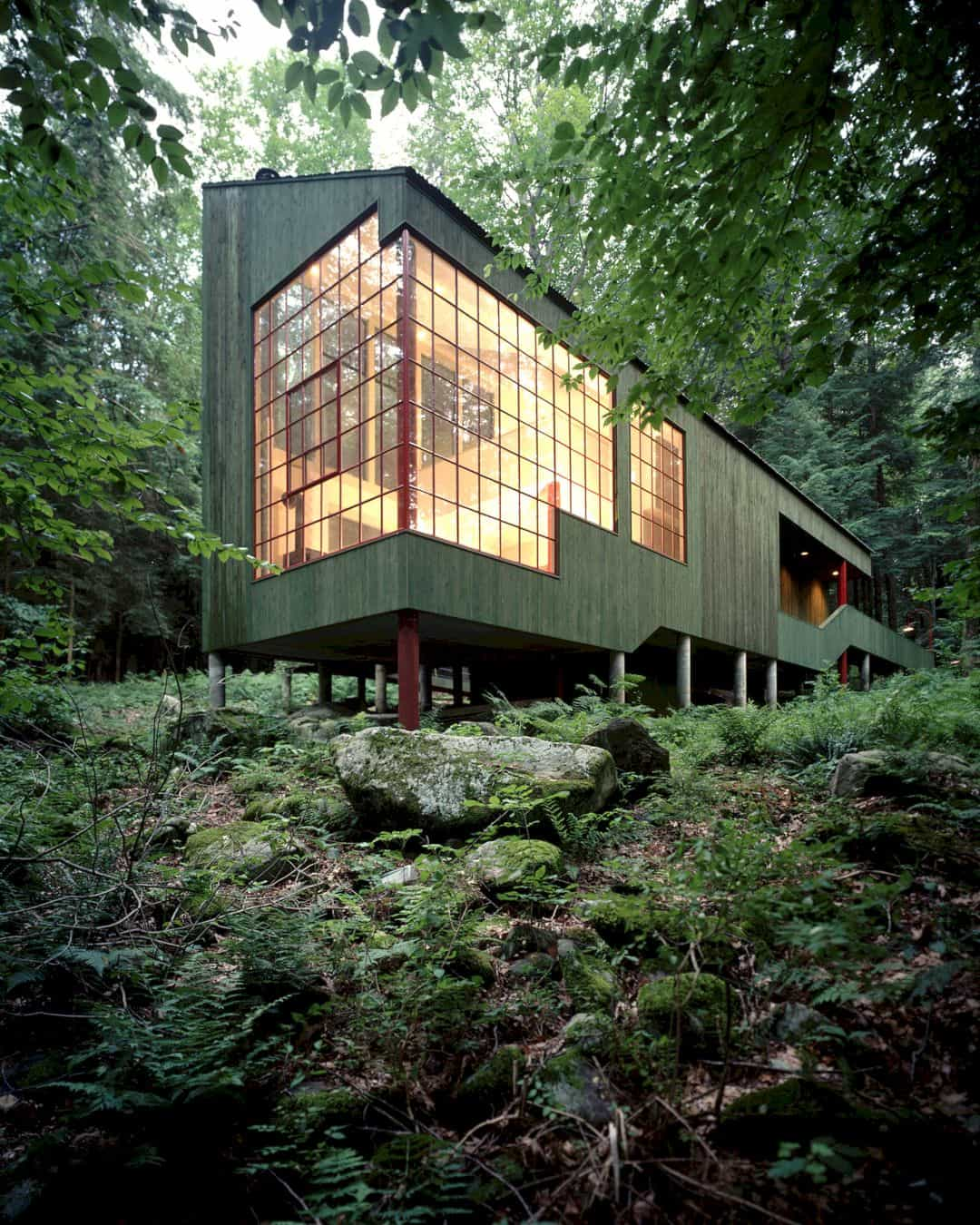Forest House: A Small Summer Home within Dark Evergreens and Bright Woodland