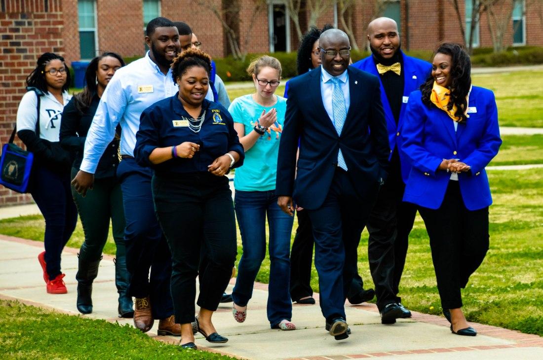 Dr. Paul Jones and student walking across FVSU's campus