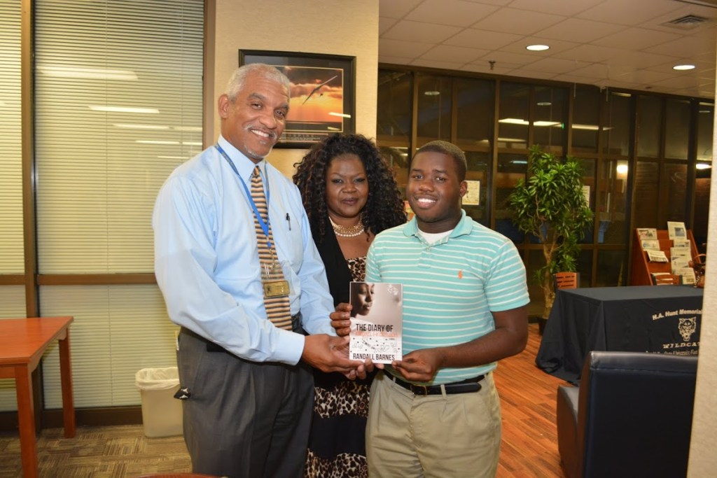 Wallace Keese, dean of students and Randall Barnes and his mother at the author's book signing.