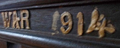 Detail of rail before restoration showing some of the missing lettering