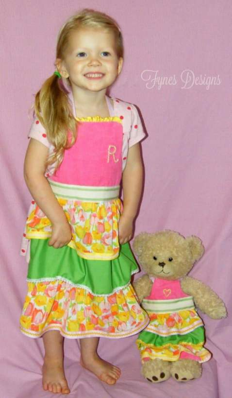 Cute toddler and teddy ruffled apron