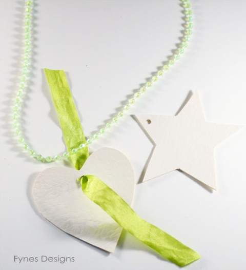 Cut shapes from canvas or upholstery vinyl for kids to decorate and make necklace pendants
