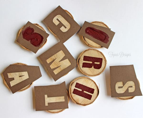 Stencil wood slices to create a @Christmas garland