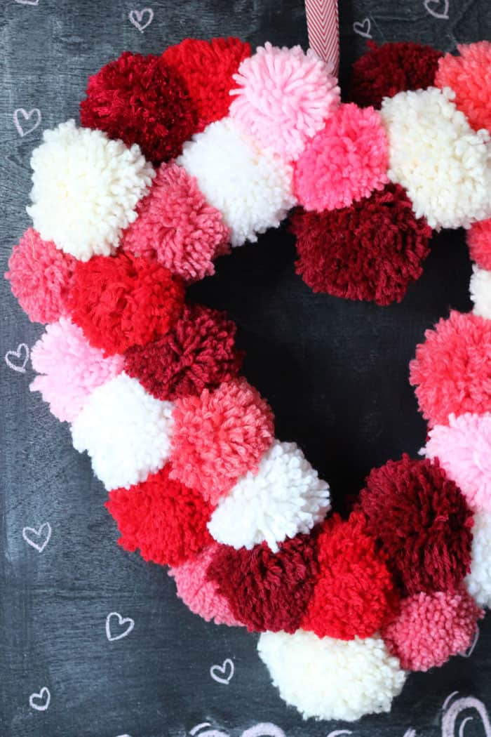 Yarn Wrapped Hearts tutorial featured by top US craft blog, Fynes Designs: Valentines Day Pom Pom Wreath