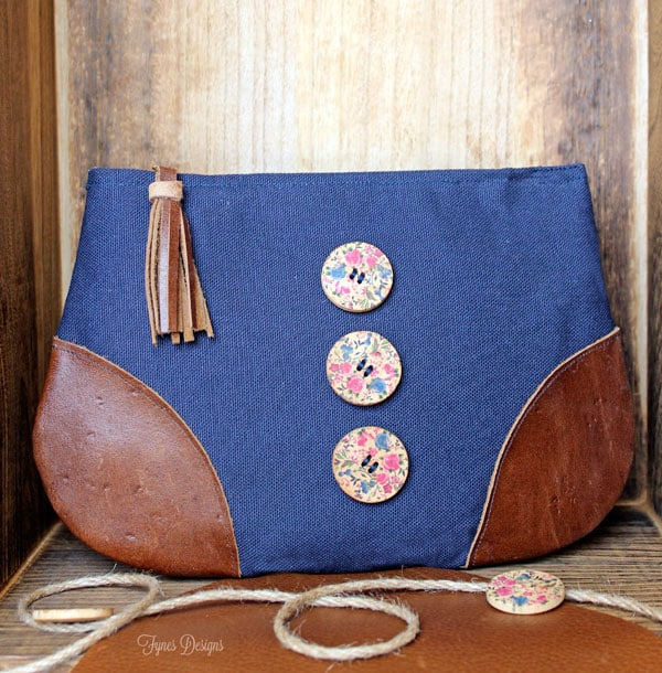Add leather to the corners of a basic zipper pouch for a unique design