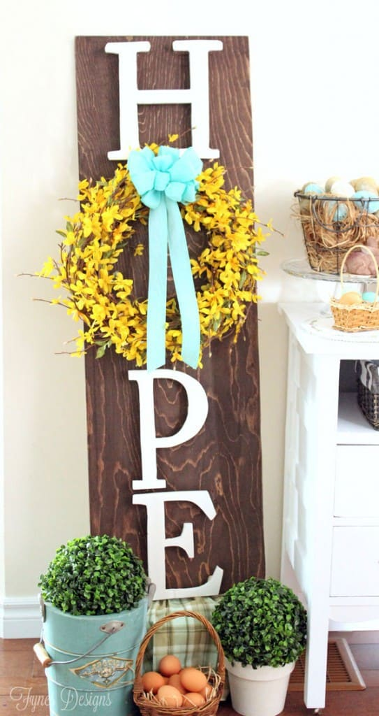 Easter wooden wreath sign #minwax #easter #mayartsribbon #forsythia | Easy Spring Wreath Idea by popular interior design blog, Fynes Designs: image of a Hope wreath hanger.