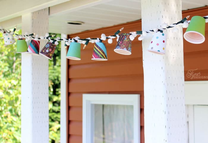 Cover small plastic cups with pattern paper to create cute patio lanterns.