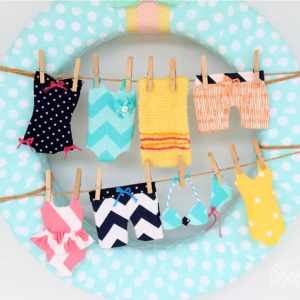 Fun wreath idea- Tiny swimsuits on the clothesline