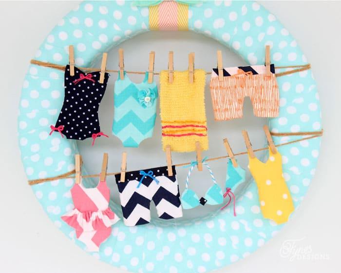 Fun wreath idea- Tiny swimsuits on the clothesline