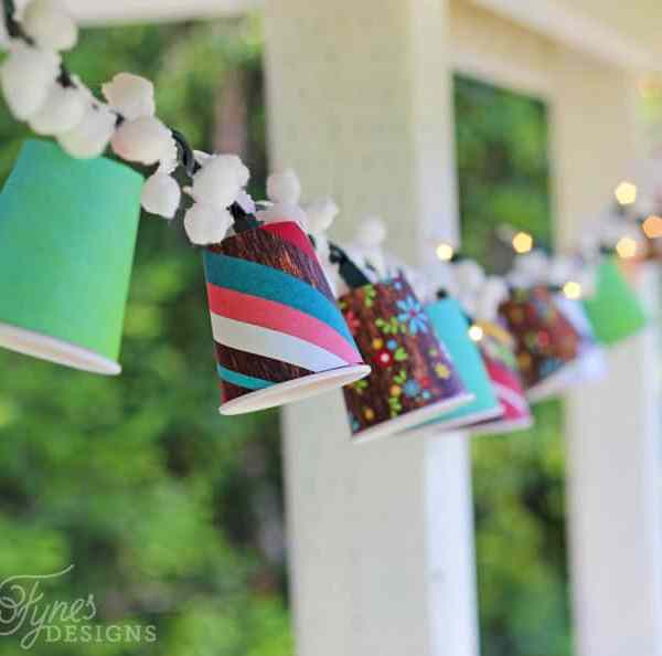 Create cute patio lanterns by adding pattern paper to small plastic cups