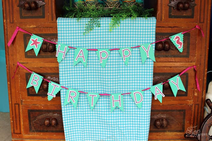 birthday banner made with Michaels wood buntings and the Silhouette Cameo
