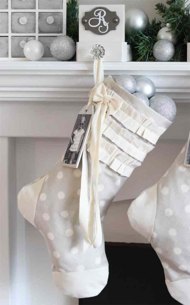 Free Christmas Stocking sewing pattern |DIY Wooden Sled by popular Canada DIY blog, Fynes Designs: image of a grey and white polka dot stocking filled with silver ornaments.