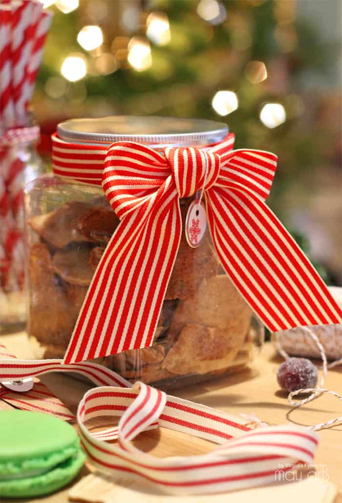 Ribbon wrapped cookie jars from the dollar store make a cute and inexpensive gift