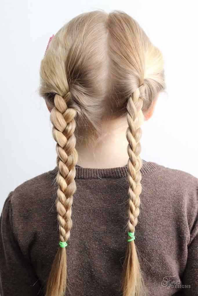 5 Minute Hairstyles for School featured by top US life and style blog, Fynes Designs: Braid pigtails |5 Minute Hairstyles by popular Canada lifestyle blog, Fynes Designs: image of braid pigtails.