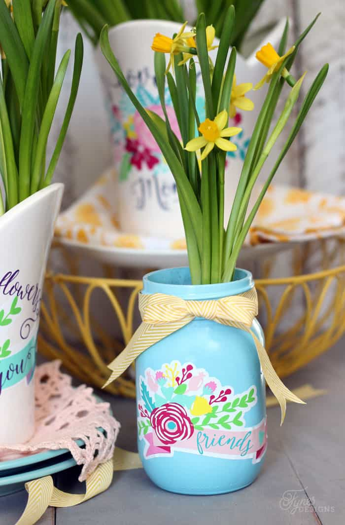 Spray paint and Decorate mason jars with Silhouette Vinyl Decals to create a beautiful plant pot.  Perfect gift idea