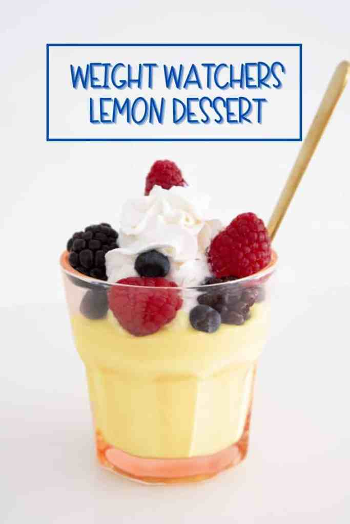 Lemon Weight Watchers Dessert. Simple no bake recipe and only 2 WW points |Weight Watchers lemon dessert by popular Canada lifestyle blog, Fynes Designs: image of a Weight Watchers lemon dessert in a glass cup and topped with berries and whipped cream.