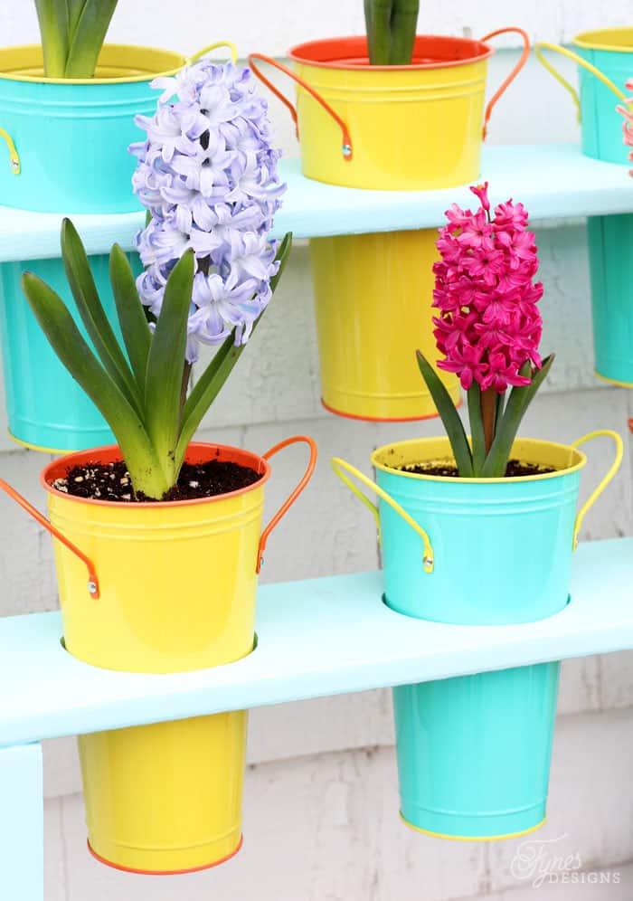 Dollar Store flower pots displayed in a DIY patio planter