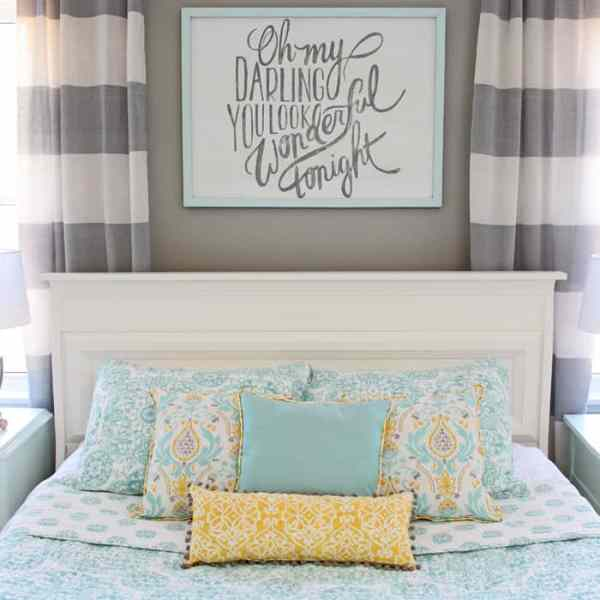 Top 10 Cheap Bedroom Decoration Ideas for Girls featured by top US DIY and interior design blog, Fynes Designs: Blue, yellow and grey master bedroom