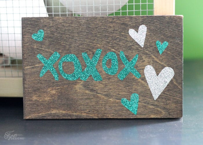 How to Use Heat Transfer Vinyl on Wood, a tutorial featured by top US home decor blog, Fynes Designs | Glitter HTV on wood- easy tutorial