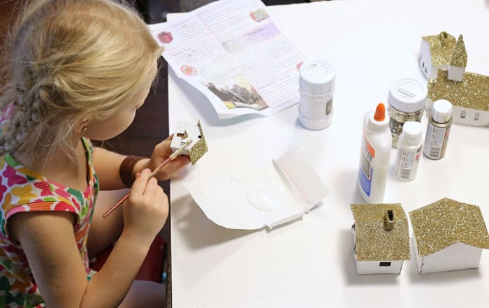 paint the cardboard with glue, and sprinkle with glitter