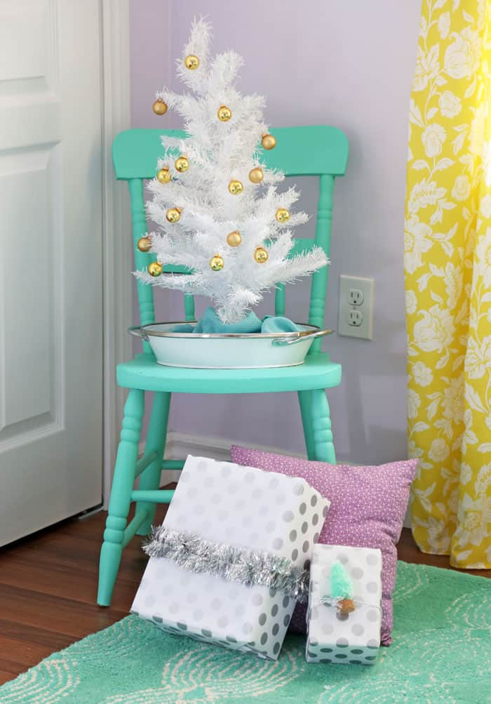 Colorful Christmas tree in a little girls room- This house has 10 trees!