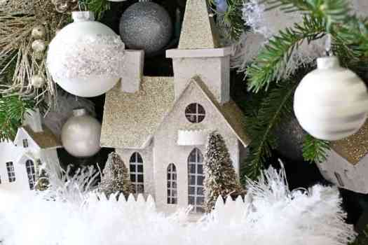 Christmas village tree. Decorated with glistening houses and beautiful white bulbs