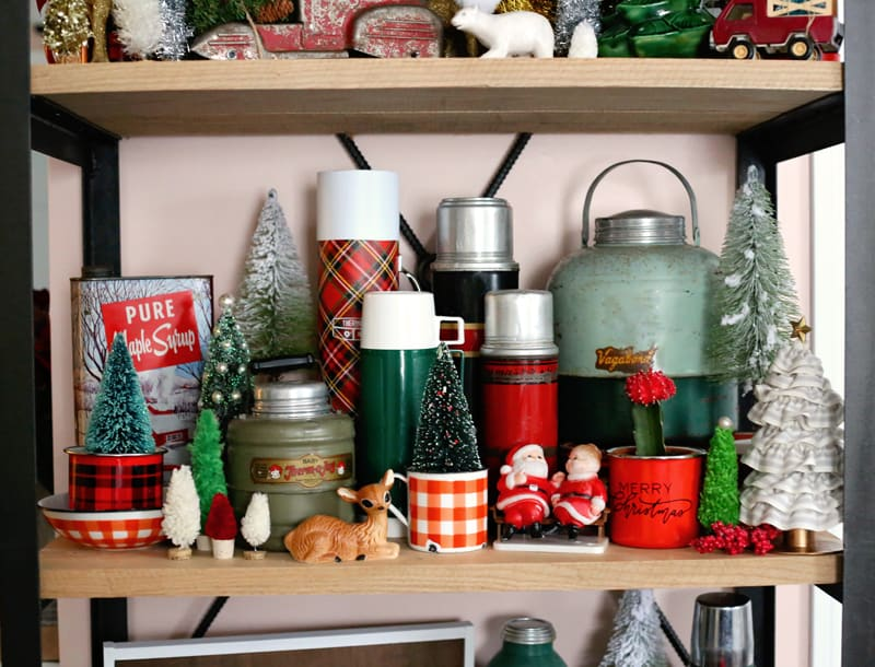 Vintage inspired Christmas Vingnette with thermos, old santas, wool blankets and hand painted signs.