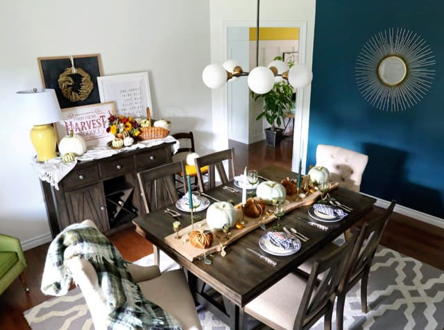 Modern farmhouse dining room decorated for fall