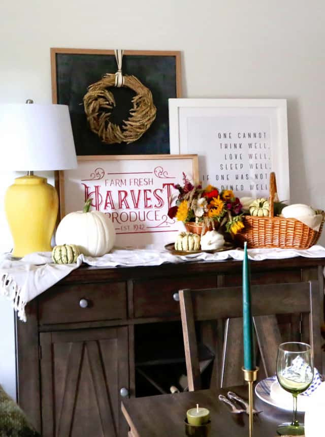 Thanksgiving dining room decorations. Hand painted signs and pumpkins