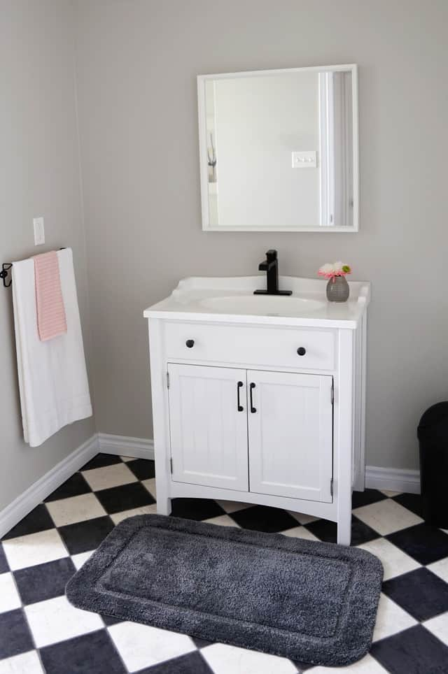 Update a builder grade bathroom vanity with new hardware and a Delta faucet