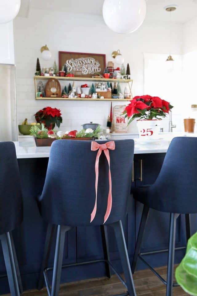 Christmas ribbons on upholstered kitchen chairs
