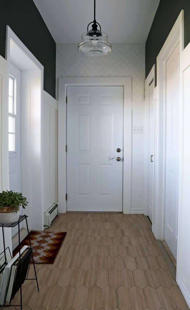 Modern mudroom with tile detail and board and batten trim work