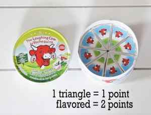 Low Point Weight Watchers snacks under 3 points featured by top US life and style blog, Fynes Designs: Laughing Cow Cheese wedge |Weight Watchers Snacks by popular Canada lifestyle blog, Fynes Designs: image of Light Laughing Cow cheese.