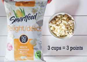 Smart Food White Cheddar Popcorn. Great Weight Watchers Snack |Weight Watchers Snacks by popular Canada lifestyle blog, Fynes Designs: image of Smartfood white cheddar popcorn.