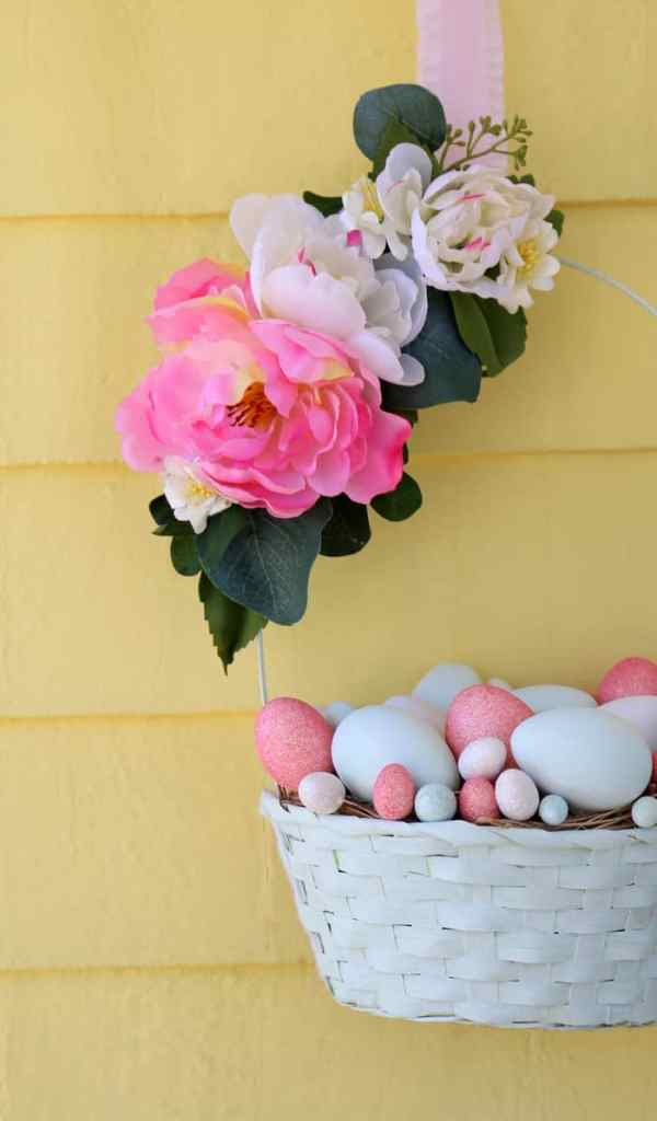 How to Make a Easter basket into a wreath for your front door. | Easy Spring Wreath Idea by popular interior design blog, Fynes Designs: image of a Easter basket wreath.