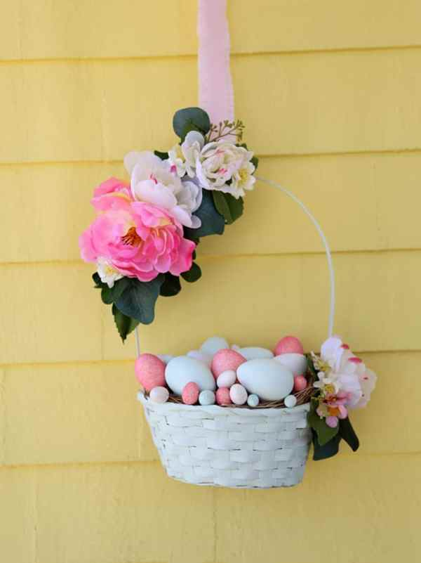 An Easter basket full of eggs for your front door. Create this Easter wreath with items from the dollar store!