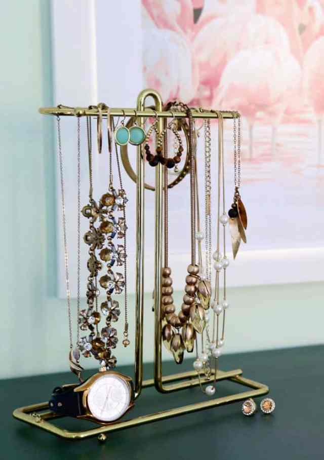 Use a hand towel holder for jewelry | Bright and Colourful Master Bedroom refresh | Colorful Master Bedroom Refresh by popular home decor blog, FYN Designs: image of a jewelry holder.