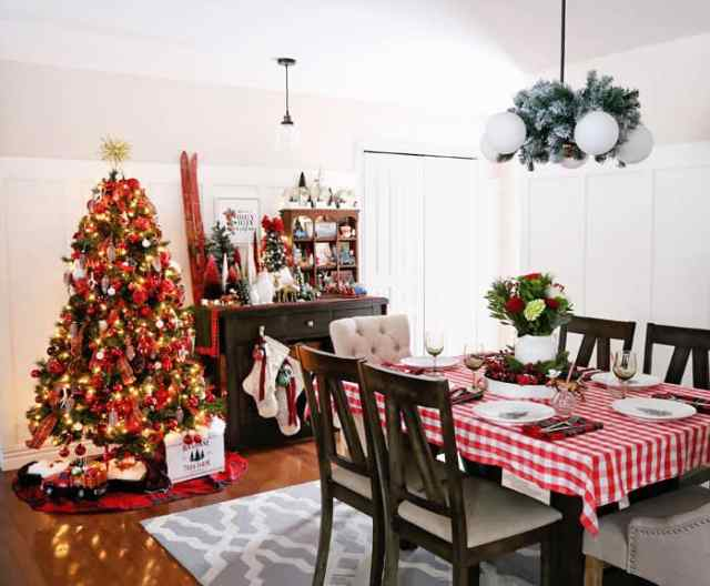 Christmas Home Decor Tour featured by top US design blog, Fynes Designs: Red and plaid themed dining room Christmas decorations | Holiday Home Decor Tour 2019 by popular Nova Scotia life and style blog, FYNE Designs: image of a dining room with a Christmas tree with red ornaments and a table with a red plaid table cloth.