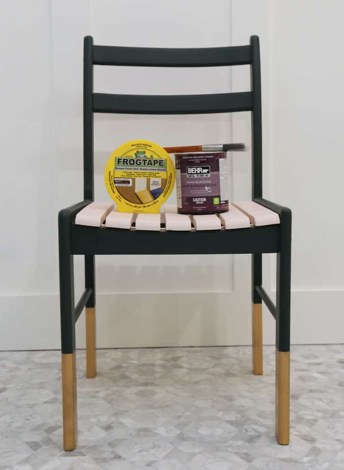 thrifted table and chair painted | Jeffrey Court Tile by popular US life and style blog, Fynes Designs: image of a chair painted with Behr Black Evergreen, gold spray paint, and Behr Stollen Kiss.