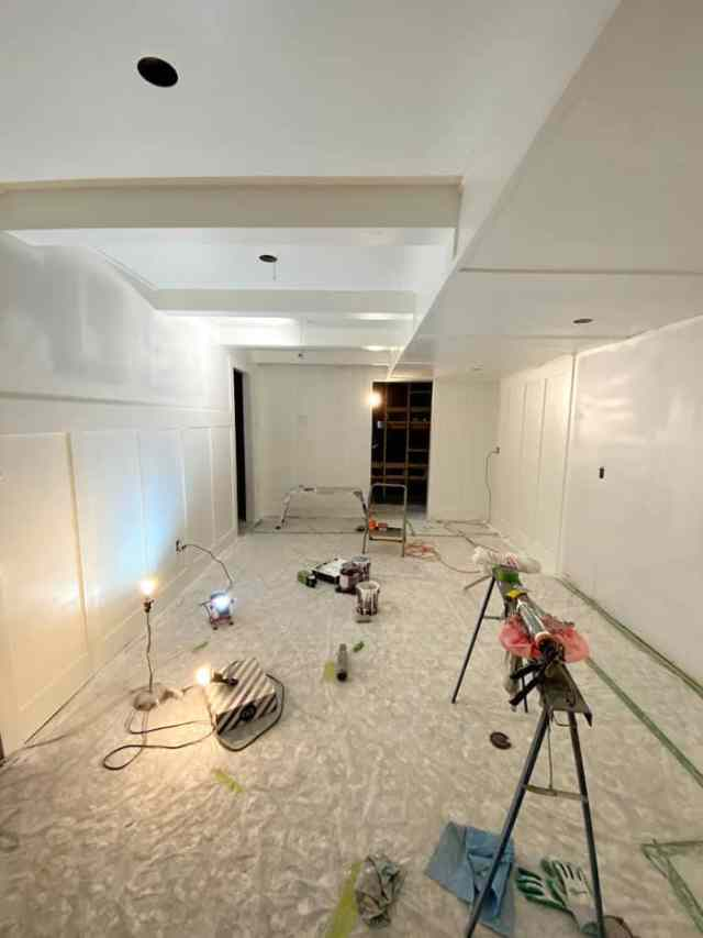 ceiling beams   Jeffrey Court by popular US interior design blog, Fynes Designs: image of a basement with a white board and batten wall and faux beams.