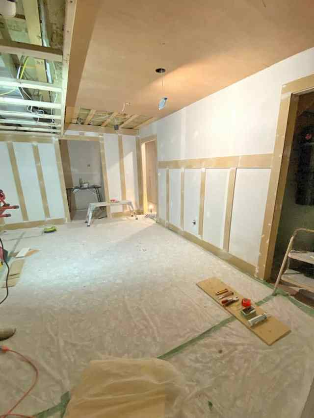 adding board and batten to drywall | Jeffrey Court by popular US interior design blog, Fynes Designs: image of a basement with a board and batten wall.