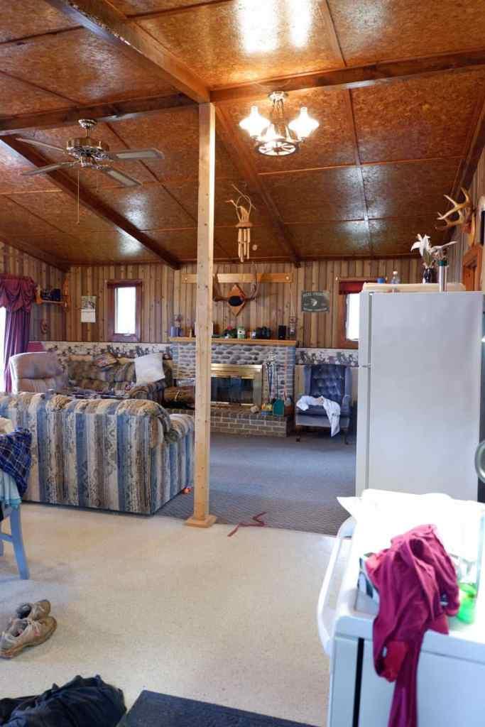 1980's cottage gets a major makeover to make it into a farmhouse cottage |Farmhouse Cottage by popular Canada DIY blog, Fynes Designs: before image of a 1980's farmhouse cottage living room.