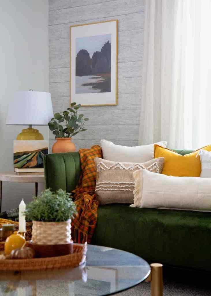 IKEA hacks: NO SEW boho pillows | Boho Pillows by popular Canada DIY blog, Fynes Designs: image of various boho pillows on a green velvet couch.
