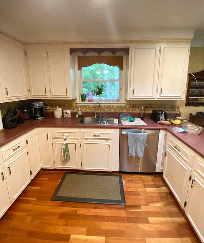 Outdated kitchen in a 1990's split entry | Kitchen remodel before and after by popular Canada DIY blog, Fynes Designs: before image of a 90's kitchen.