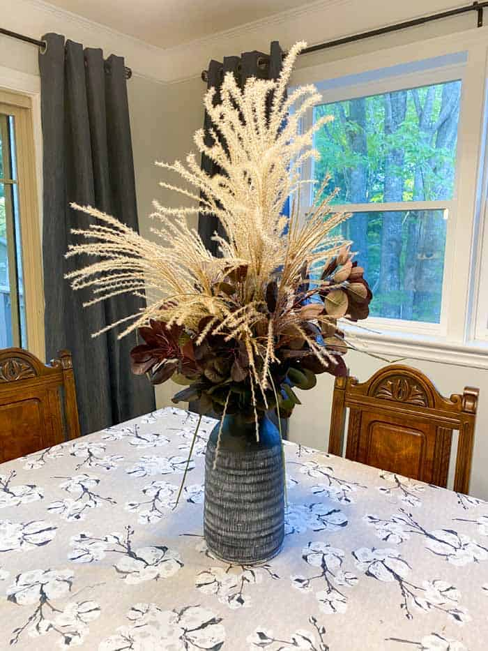 Kitchen remodel before and after by popular Canada DIY blog, Fynes Designs: after image of a 90's kitchen with a antique dining table and faux floral centerpiece.