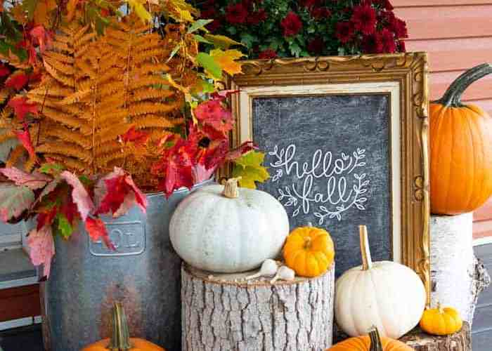 Hello Fall sign on a fall front porch