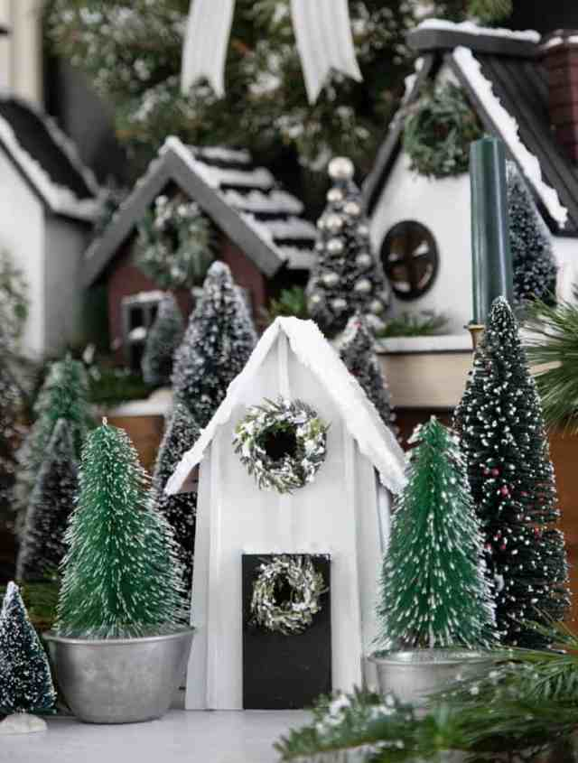 Joanna Gaines Farmhouse Christmas Village holiday craft |Christmas Village by popular Canada DIY blog, Fynes Designs: image of a farmhouse Christmas village.