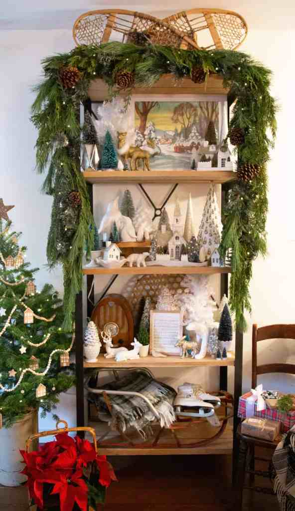 How to hang garland on a shelf | How to Hang Garland by popular Canada DIY blog, Fynes Designs: image of garland hanging on a shelf decorated with various Christmas decor items.